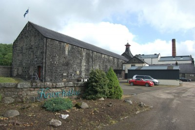 The distillery, complete with bright red mid-life crisis car