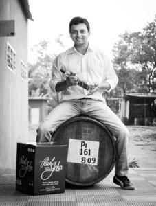You're not allowed to call yourself a master distiller until you've been photographed sitting on a barrel of your whisky...