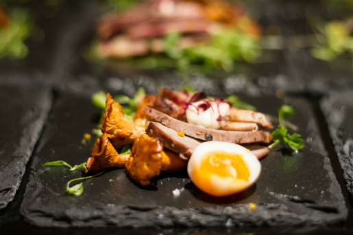 Rebel Dining Society's Duck Confit with Quail Egg & Girolles