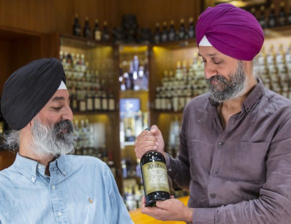Sukhinder and Rajbir Singh with a bottle of Ardbeg 1976 Manager's Choice