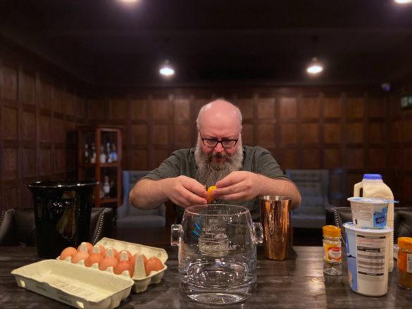 Making Eggnog - separating egg yolks